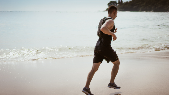 a man jogging by the beach