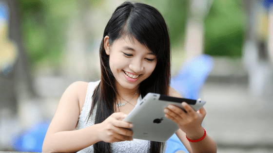 a girl chatting on her ipad